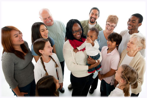 Diverse Group Smiling at Woman Holding Baby
