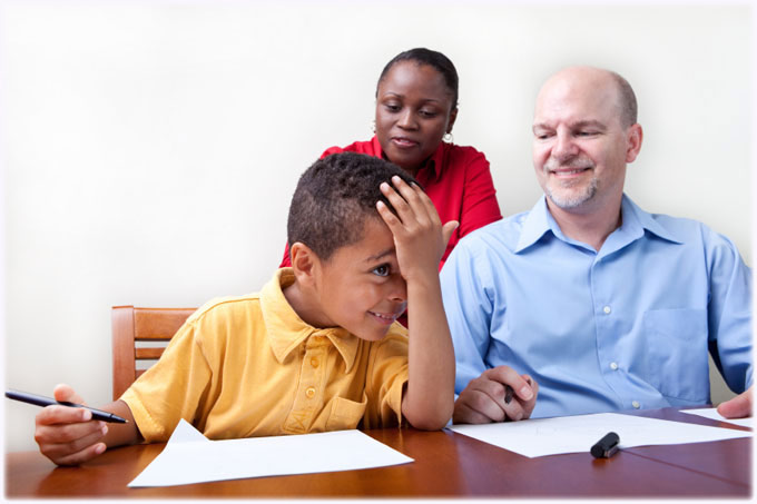Child Cheerfully Learning with Parental Guidance